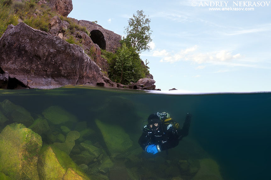 Diver dives on rail tunnel, lake Baikal, Siberia, Russia, Eurasia