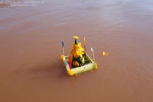 Pha Sat for holy Brahmin rite (a floating object made from the leaf  of the banana tree and decorated with beeswax in a flowerlike shape) floating on the Mekong River, Loei province, Thailand