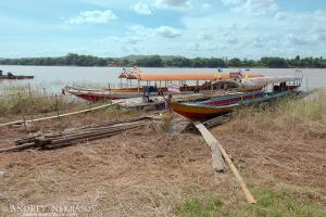 Traditional Thai longtail boat in the Mekong River, Loei province, Thailand