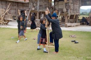 Children Tai Dam play traditional games, Loei province, Thailand