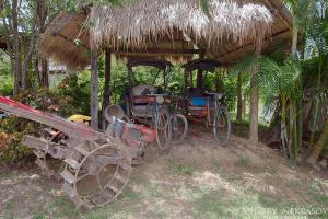 Two tricycle standing under the awning, Loei province, Thailand