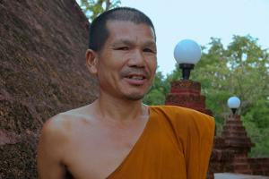 Buddhist monk in a Wat Neramit Wipatsana Temple, Dan Sai District, Loei province, Thailand