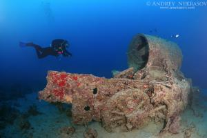 Diver looking at a steam locomotive, shipwreck SS Thistlegorm (British armed Merchant Navy ship), Red Sea, Egypt