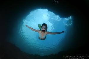 Woman diving into a cave, Black Sea, Crimea, Ukraine, Eastern Europe