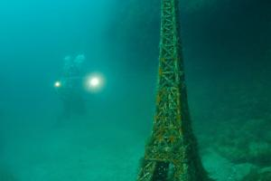 Underwater museum Reddening leaders Eiffel Tower sculpture. Cape Tarhankut, Tarhan Qut, Black sea, Crimea, Ukraine, Eastern Europe