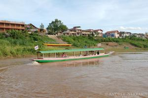 Traditional Thai longtail boat floating on the Mekong River, Loei province, Thailand