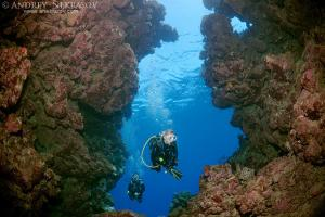 Diver in cave. Ras Muhammad National Park, Sinai Peninsula,  Sharm elSheikh, Red sea, Egypt, Africa
