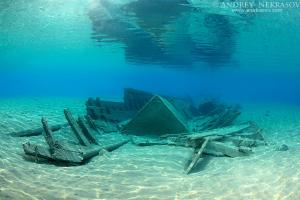 old wrecked wooden fishing boat on the sandy bottom, Red sea, Marsa Alam, Egypt